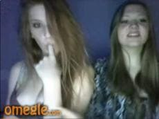 Two coeds kissing topless on Omegle