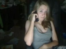 Amateur teen talking on phone and flashing