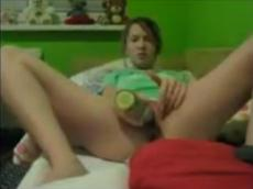 Homemade video - teen masturbates using cucumber